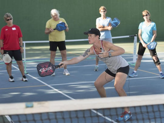 National Pickleball champion Sarah Ansboury works with local players at Plaza Park in Visalia on Wednesday.