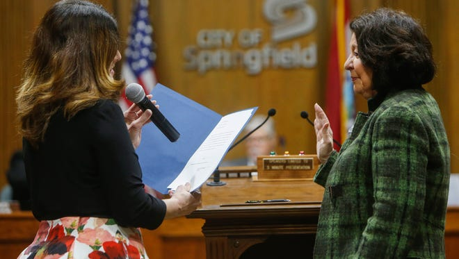 City Clerk Anita Cotter swears in City Council member Jan Fisk on Tuesday, April 11, 2017.