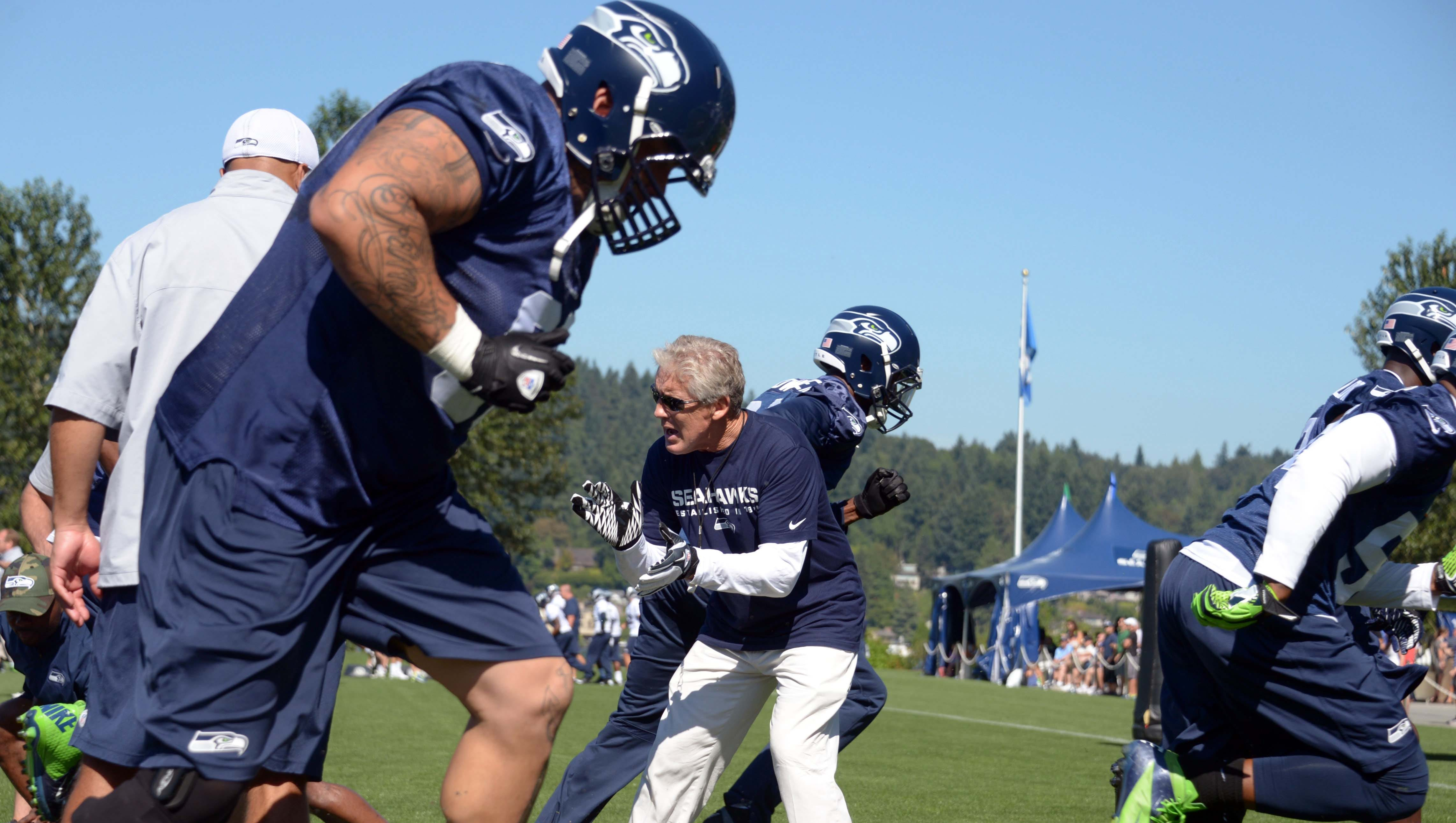 Seattle Seahawks coach Pete Carroll supervises drills at training camp at the Virginia Mason Athletic Center.