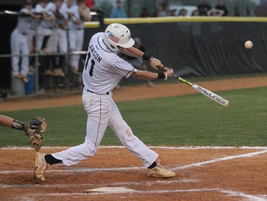 Madison County's Dilan Lawson blasts a hit during last