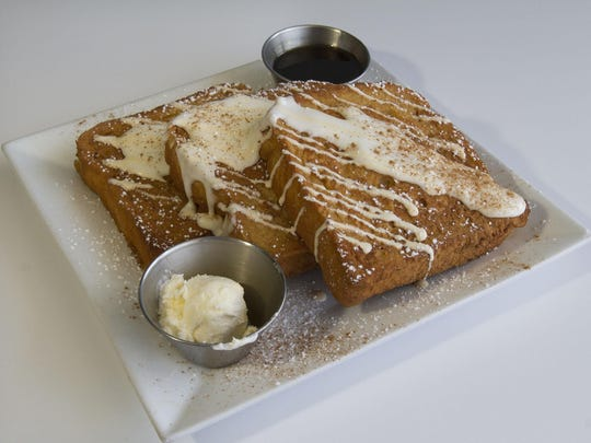 The Churro French toast at Meemom's Kitchen in Wall is topped with cream cheese glaze, cinnamon sugar and vanilla sauce.