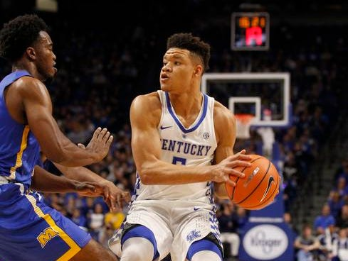 Kentucky Wildcats forward Kevin Knox (5) passes the ball against the Morehead State Eagles in the first half at Rupp Arena.