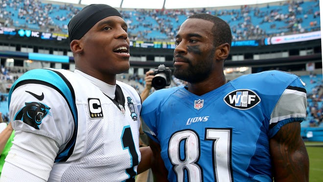 Cam Newton of the Carolina Panthers, left, talks with Calvin Johnson of the Detroit Lions after a game Sept. 14, 2014, in Charlotte, N.C.