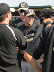 Corunna coach Chuck Osika addresses his team following