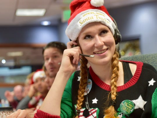 NORAD Tracks Santa volunteer Camille Bazin gives an update on St. Nick's location to a caller on Christmas Eve.
