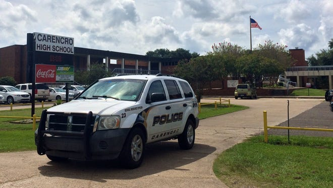 Police monitor Carencro High School during a lockdown in August 2014. Officials said such lockdowns are often more of a precaution and a collaborative effort among school officials and law enforcement.