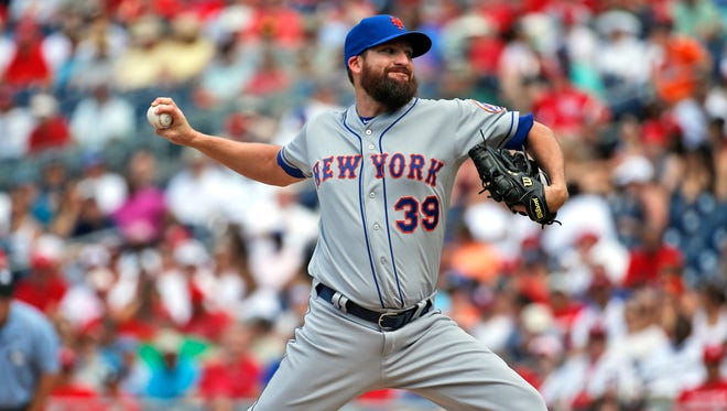 New York Mets relief pitcher Bobby Parnell throws during the eighth inning against the Washington Nationals on July 22, 2015, in Washington.