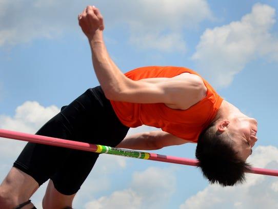 Brighton's Noah Grimm won the high jump with a jump