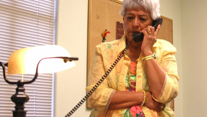 Janet Reeves, Executive Director of Nevada Urban Indians speaks on the phone.