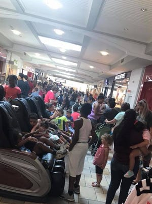 A crowd of customers lined up for the Pay Your Own Age promotion at the Build-a-Bear store at the Castleton Square Mall in Indianapolis on Thursday, July 12, 2018.