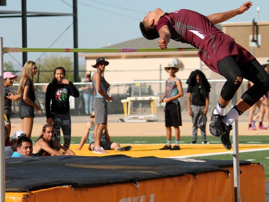 Tularosa's Joe Perez jumps over the horizontal bar during the high jump event Saturday morning at Tiger Stadium.