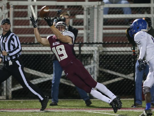 Alcoa's Connor Canfield (19) catches a pass in front