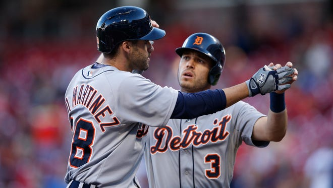J.D. Martinez, left, of the Detroit Tigers is congratulated by Ian Kinsler after hitting a three-run home run against the Cincinnati Reds on Aug. 24, 2015, in Cincinnati.