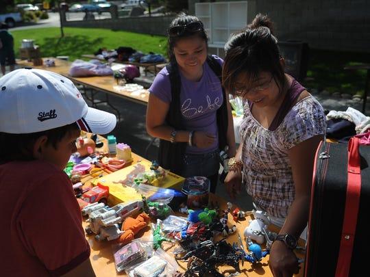 Shoppers enjoy the Hidden Valley community garage sale in 2010.