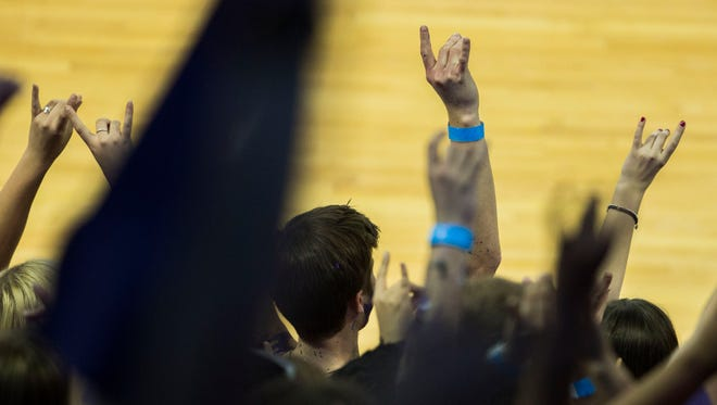 GCU fans put up the antlers hand gesture during a game at Grand Canyon University Arena in Phoenix.