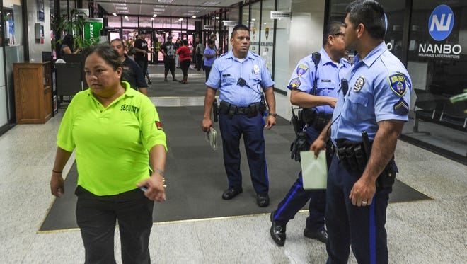 Guam Police Department officers and security personnel could be seen in the first-floor lobby of the International Trade Center building after people were allowed to re-enter the structure following a reported bomb threat on Tuesday, Aug. 30.
