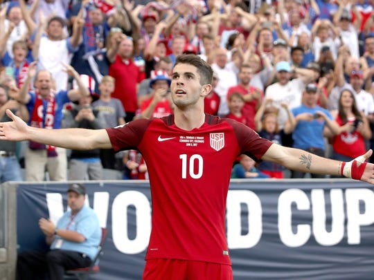Christian Pulisic of the U.S. National Team celebrates scoring a goal against Trinidad & Tabago in the second half during the FIFA 2018 World Cup Qualifier at Dick's Sporting Goods Park on June 8 in Commerce City, Colo.