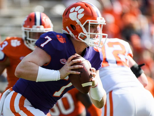 Clemson quarterback Chase Brice (7) runs with the ball