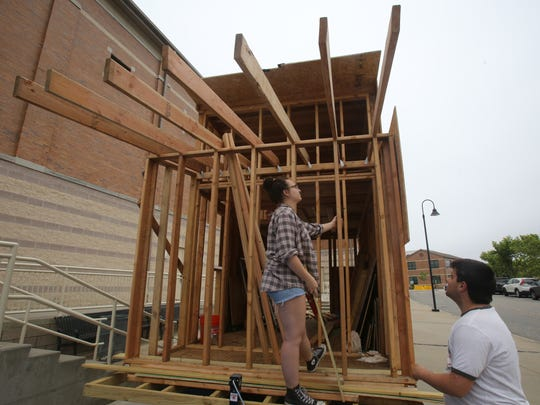 Irvington High School's Remy Mermelstein, 18 and Nikki Chase, 16, talk about what needs to be done to the Tiny House they are building at the high school in Irvington June 16, 2017.