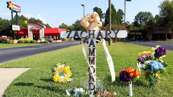 File august A cross and flowers are placed in front of the Hardee's on U.S. 123 in Seneca where Zachary Hammond was shot and killed by a police officer