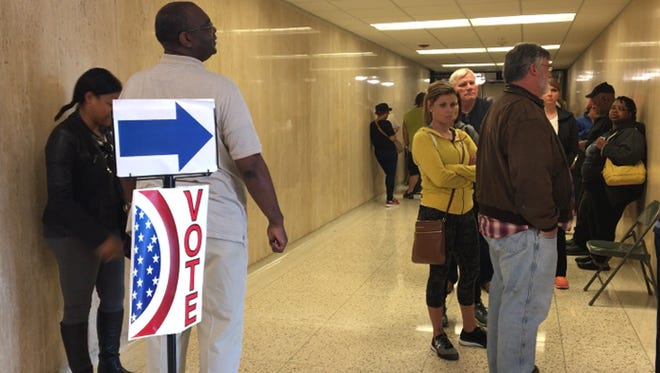 People wait outside the Clark County Clerk's office Nov. 7 to cast their ballot in the 2016 election.