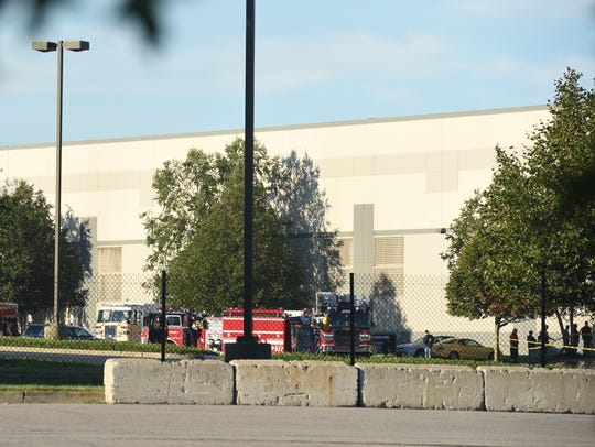 Firefighters remain on scene of the Gap Inc. distribution