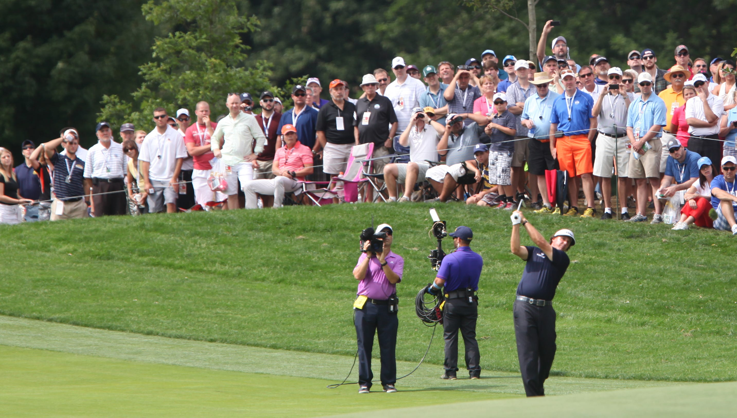 The gallery along 18 was already packed as Phil Mickelson shoots from the fairway before 11:30 a.m. Sunday morning.