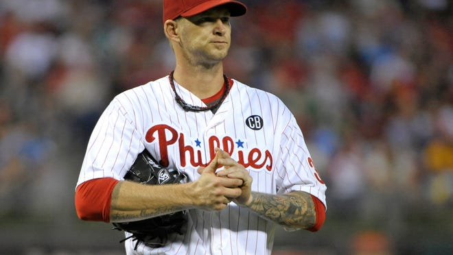 Phillies starting pitcher A.J. Burnett reacts after allowing a run in the fourth inning against the New York Mets on Friday at Citizens Bank Park.