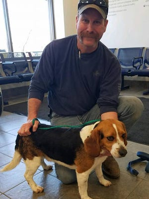 Gregory the rescued beagle and Joe Kirk, his rescuer.
