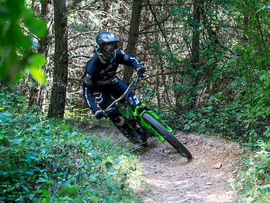 Ian Norris, 18, turns into a corner at Codorus State Park. Norris became interested in downhill mountain biking after watching videos of the sport on YouTube.