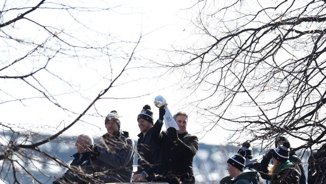 Philadelphia Eagles head coach holds up the Vince Lombardi Trophy with quarterbacks Carson Wentz and Nick Foles during the Super Bowl LII victory parade, Thursday, Feb 8, 2018, in Philadelphia.