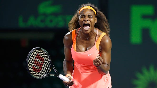 Serena Williams celebrates against Simona Halep (not pictured) during a women's singles semi-final on day eleven of the Miami Open at Crandon Park Tennis Center.