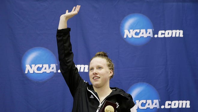 Indiana's Lilly King waves after receiving the trophy for winning the 200-yard breaststroke at the NCAA women's swimming and diving championships at Georgia Tech on Saturday, March 19, 2016, in Atlanta.