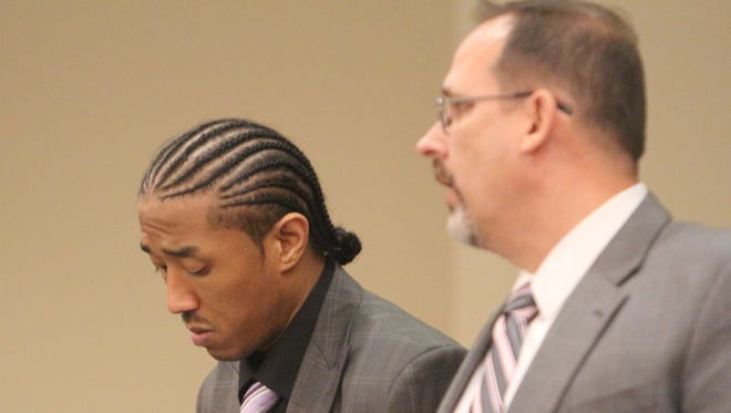 Joseph Graham, left, stands with his attorney, Roger Nell, to plead not guilty to murder before his trial began Monday.