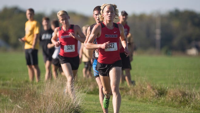 Wapahani's Alex Herbst runs with his brother closely following in the IHSAA Regional on Oct. 14 at the Muncie Sportsplex. Pendleton Heights took the overall for boys and Yorktown took the overall for girls.