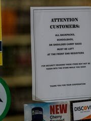 A sign on the door to Food Plus at 640 N. Seventh St. in Lebanon, on Wednesday, Dec. 2, 2015, notifies customers that they need to leave backpacks, school bags and shoulder bags at registers for security reason. Timothy Bahner, owner of Food Plus, said the signs are an attempt to combat shoplifting.