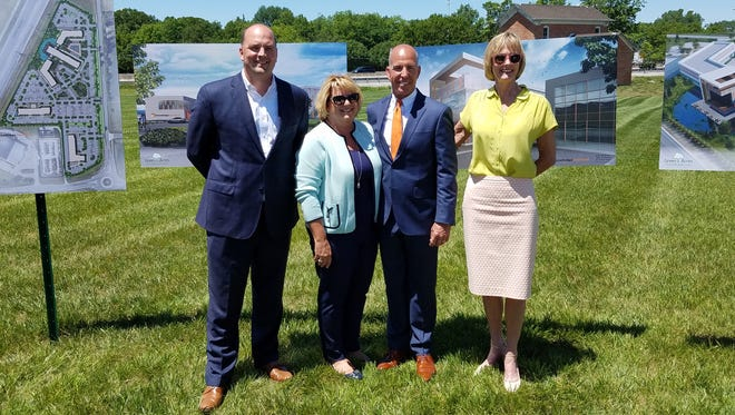 Fishers Mayor Scott Fadness, Knowledge Services CEO Julie Bielawski, Knowledge Services President Joe Bielawski and Lt. Gov. Suzanne Crouch announced the creation of the company's new 80,000-square-foot headquarters.