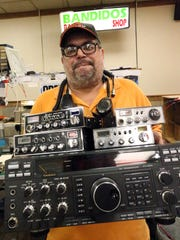 Ricardo Rosario holds a HAM radio and a variety of