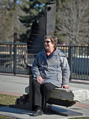 Christine Fey sits on an art piece at Bicentennial Park on Feb. 16, 2017.