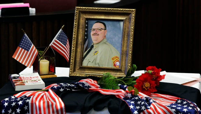 Photos and flag bunting surround a photo of the late Jack Johnson during the Veterans Day edition of Veterans Court Friday November 11, 2016 at Sheboygan County Circuit Court Branch 3 in Sheboygan.  Johnson was one of the founding team members of the special court and a former member of the Sheriff's department.