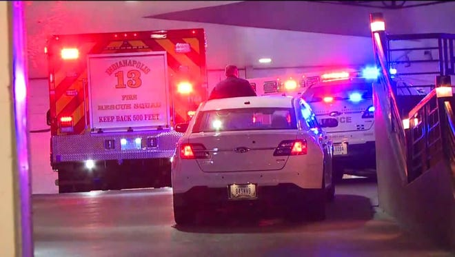 Police respond to a shooting at the Embassy Suites, 110 W.Washington Street on Monday.