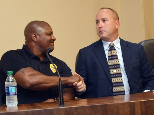 Alexandria Police Department lieutenant Patrick VanDyke (left) shakes hands with APD sergeant Jarrod King who was announced by Alexandria mayor Jacques Roy as the new Alexandria Police Department police chief on Wednesday, April 30, 2018. VanDyke was also among the police chief candidates.