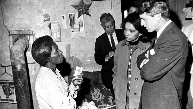 Sen. Robert F. Kennedy is shown touring the Mississippi Delta near Greenville, April 11, 1967, on an anti-poverty investigation. Marian Wright Edelman, second from right, visited poor people in the Mississippi Delta with Robert Kennedy and other U.S. senators. Wright wanted the senators to see how hard life was for poor Americans like the woman in this photo. Sen. Robert F. Kennedy is shown touring the Mississippi Delta near Greenville, April 11, 1967, on an anti-poverty investigation.  Marian Wright Edelman, second from right, visited poor people in the Mississippi Delta with Robert Kennedy and other U.S. Senators.