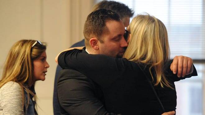 Joel Jenkins hugs family and friends after the jury reached a not guilty verdict Tuesday in Pike County Common Pleas Court.