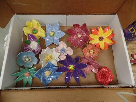 Ceramic flowers created by students at Indio High School.