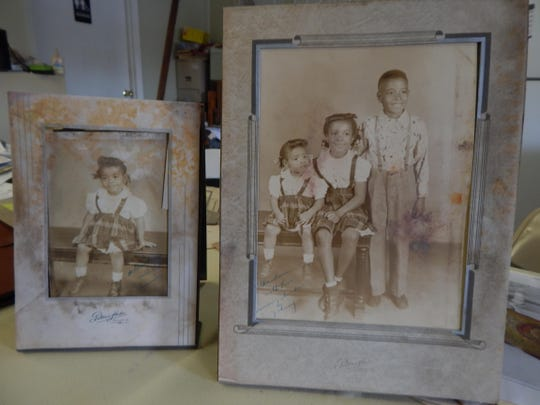 """Terry Philips and Sandra Johnson found these photos in a paper bag under a pile of plaster rubble. They came from a Chicago studio and are inscribed, """"Grandmother with love. Maureen, Sandra & Johnny."""" Johnson would like to meet the children or their descendants and return the photos to them."""