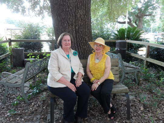 Yvette Hebert (left) and Helen W. Moore sit in the shade of a live oak tree named in Moore's honor in front of the Huey P. Long Medical Center building in Pineville.