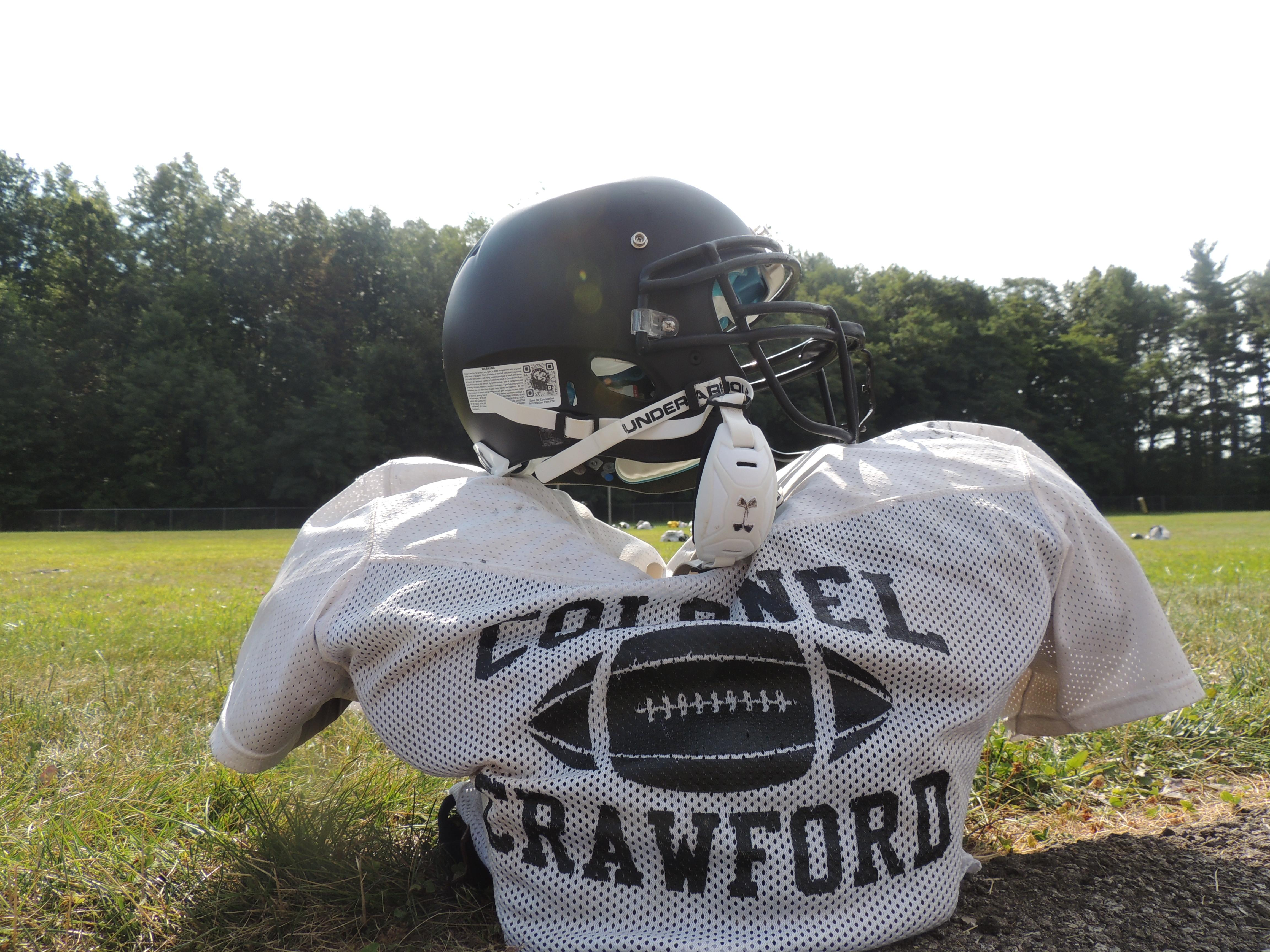 Colonel Crawford players leave their pads and helmets on the practice field while they take a break during two-a-days.