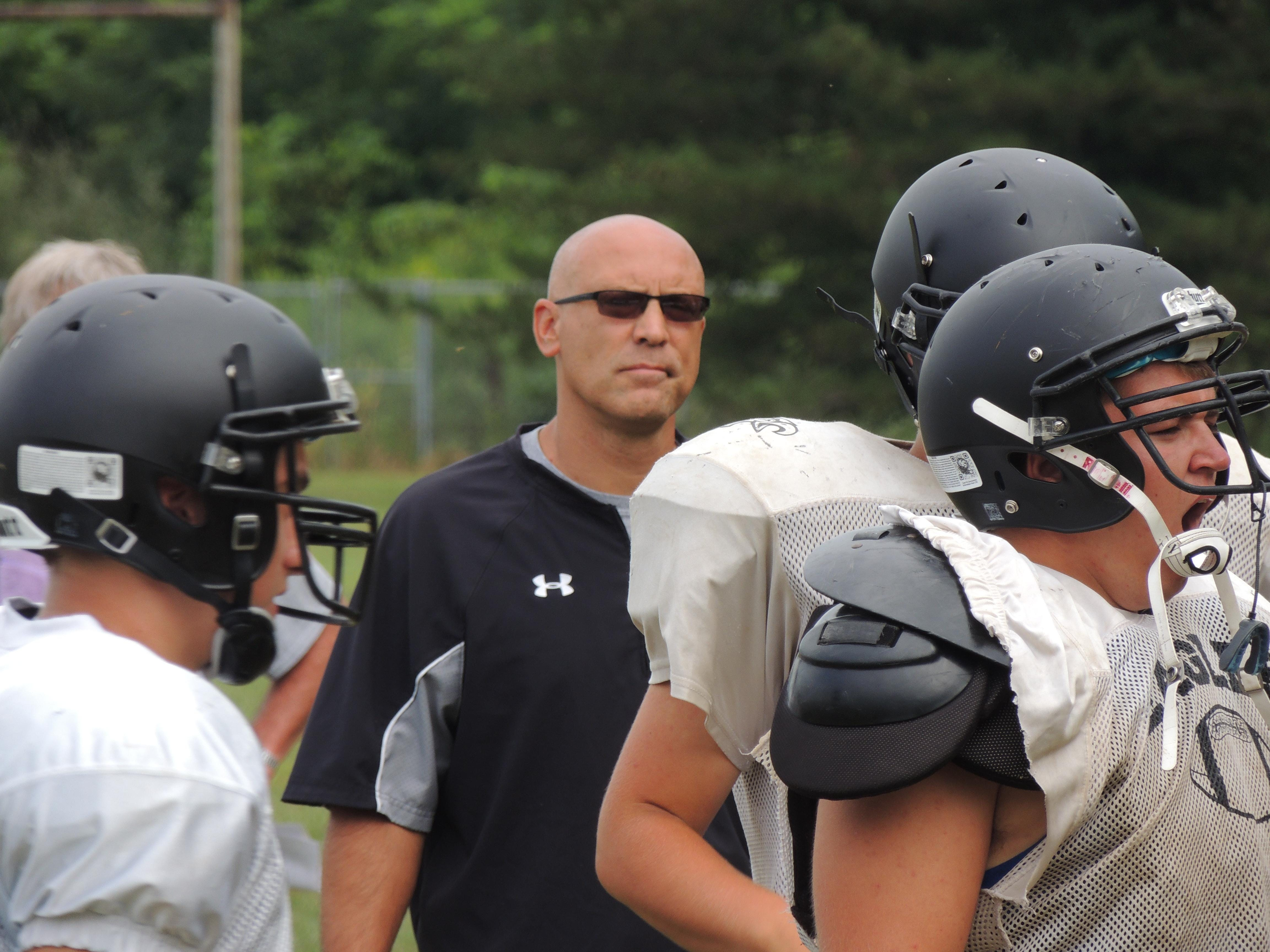 Head coach Ryan Teglovic runs the scout defense against his first team offence during practice on Monday