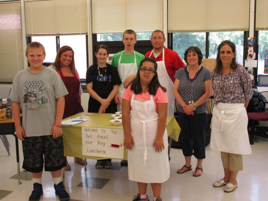 Staff members at Readington Middle School were treated to their 3rd Annual Hot Dog Luncheon on June 10. Above, lined up and ready to serve are students and teachers (from left) Robert Reed, Melissa Spatz, Marybeth Schwarz, Riley Martin, Bailey Fluke, David deVelder, Laurie Somma and Denise Hawkins. This year's menu featured baked beans, pasta salad, lemonade, an assortment of baked goods, and, of course, the star of the show – hot dogs with all the fixin's.